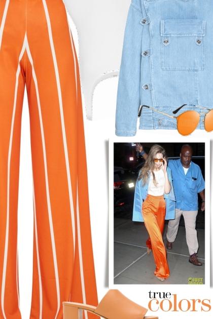 Gigi Hadid - Wearing a Pair of Orange Trousers