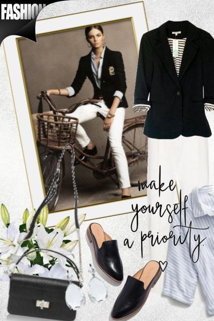 Hvit bukse og sort jakke
