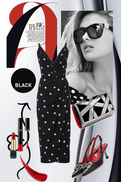 Sort kjole med prikker