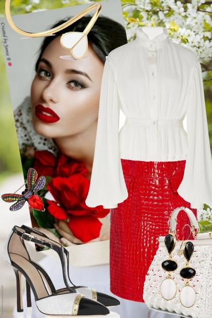 Rødt skinnskjørt og hvit bluse