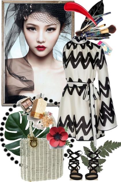 Sort og hvit mønstrete kjole