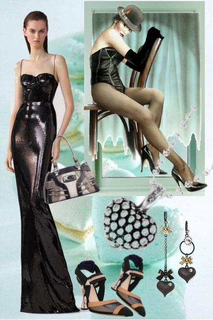 Sort sid kjole med sort tilbehør