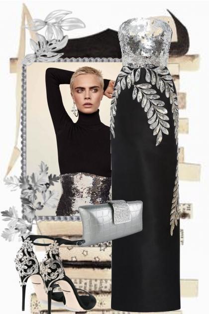 Sort kjole med sølvdekor