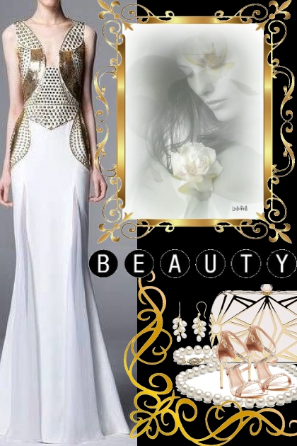 Zuhar Murad Gold & White Gown!