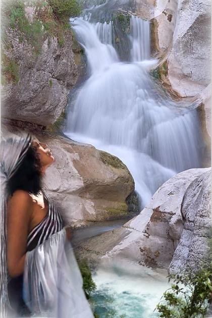 A girl by the waterfalls